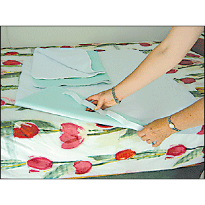 Bed pad with handles